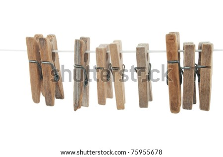 wooden clothespins on rope  on white background - stock photo