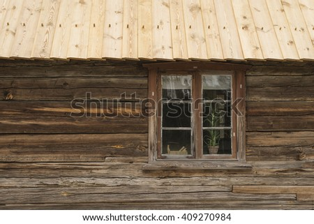 wooden cottage with window - stock photo