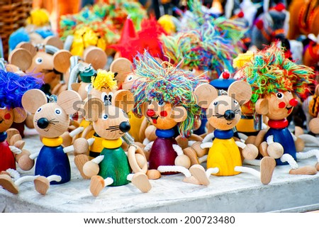 wooden figurines toys at the fair - stock photo