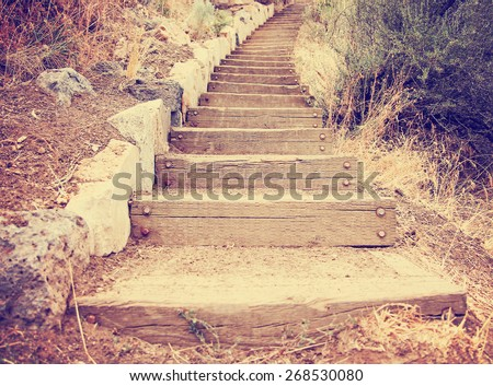 wooden steps going up a hill toned with a retro vintage instagram filter effect app or action  - stock photo