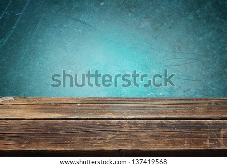 wooden table against blue textured background - stock photo