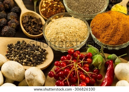 Wooden table with colorful spices, herbs and vegetables.  Wooden table with colorful spices. Asian cuisine
