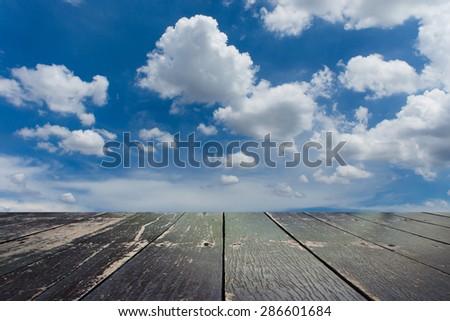 Wooden walkway and beautiful sky background - stock photo
