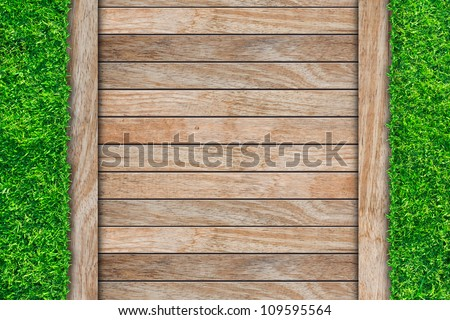 wooden with green grass background