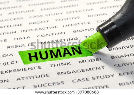 Word human highlighted with marker on paper of other related words. For direction of business strategy success concept - stock photo