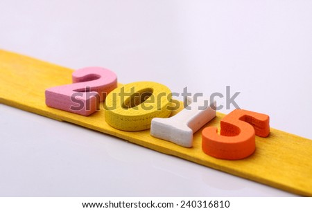 2015 word on yellow wooden - stock photo