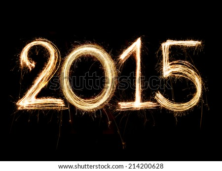 2015 word written with Sparkle firework on black background - stock photo