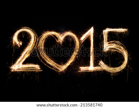 2015 word written with Sparkling figures on black background - stock photo
