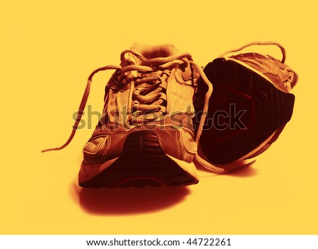 Worn Sneakers Trainers color toned - stock photo
