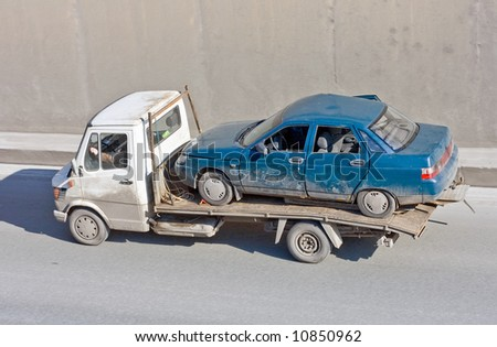 "wreck car carrier truck deliver damaged car to repair box - See similar images of this ""Business vehicles"" series in my portfolio - stock photo"