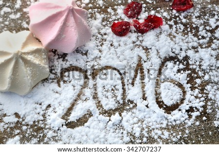 2016 writing in sugar with meringues on wooden plank