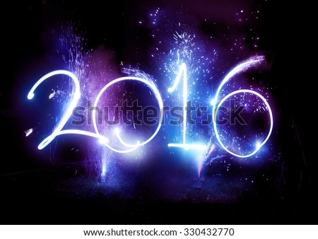 2016 written in lights trails and fireworks.  - stock photo