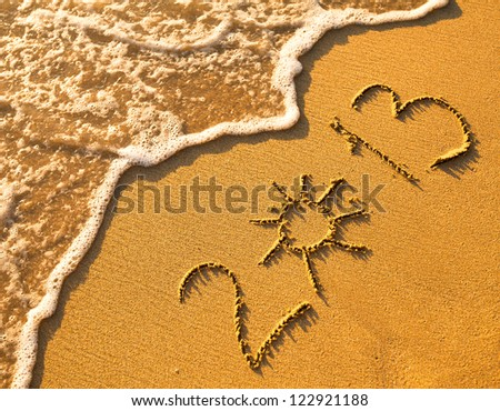 2013 written in sand on beach texture, soft wave of the sea. - stock photo