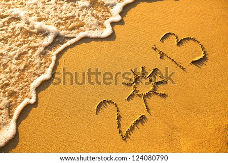2013 written in sand on beach texture - soft wave of the sea. - stock photo