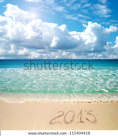2013 written in the sand - stock photo