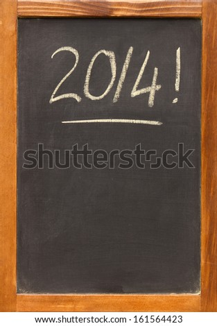 2014 written on a small chalkboard / blackboard with a wooden frame