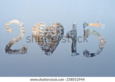 """""""2015"""" written on frosty winter window.  - stock photo"""