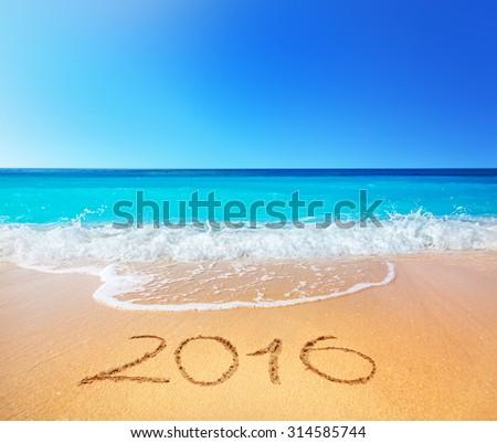 2016 written on sandy beach - stock photo