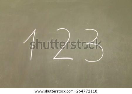 123 written on table - stock photo