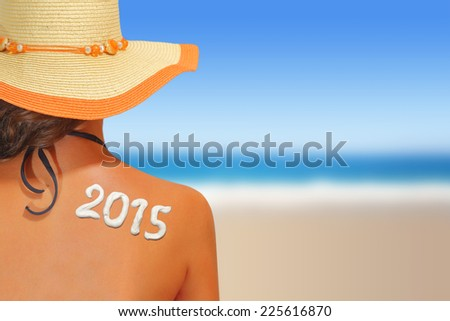 2015 written on woman's back - stock photo
