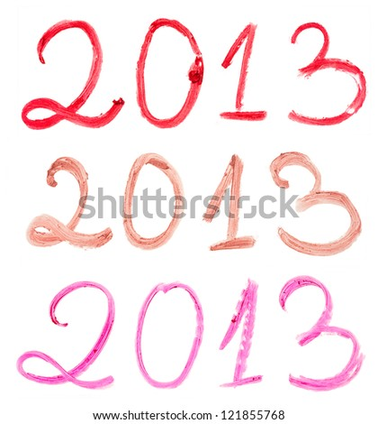 2013 written with different lipsticks isolated on white background - stock photo