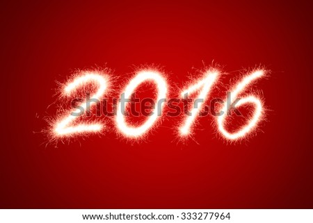 2016 written with Sparkle firework over red background - stock photo