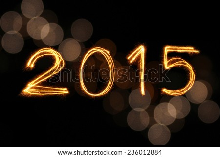 2015 written with Sparkling figures and gold blur bokeh background - stock photo