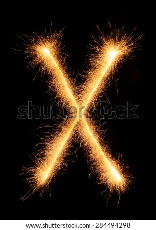 """X"" letter drawn with bengali sparkles isolated on black background"