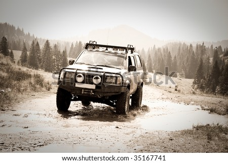 4x4 offroading through Romania - stock photo