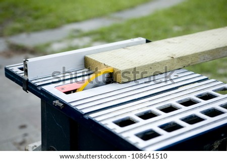 2x8 Two by Eight Wood Going through the Table Saw - stock photo