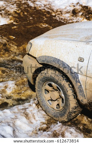 4x4 white car with mud