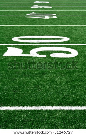 50 Yard Line on American Football Field, Copy Space, vertical - stock photo