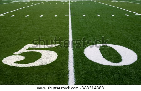 50 yard line on an american football field - stock photo