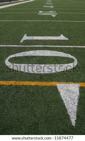 10 yard line with the field fading off - stock photo