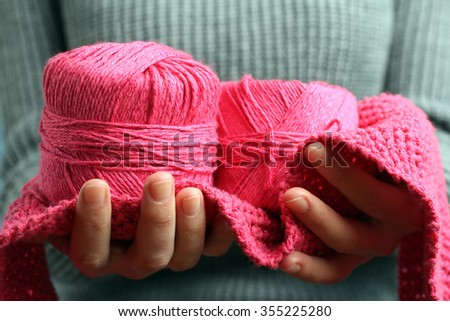 yarn for knitting in the hands of women closeup - stock photo