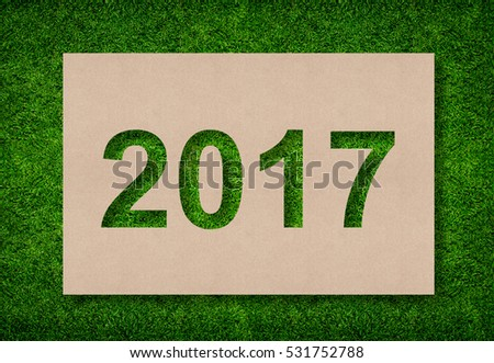 2017 Year - Alphabet number of paper cut on green grass background.