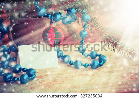 2016 year blue silver ornaments beaded necklace for Christmas tree on the background of silvery and blue Christmas decorations.