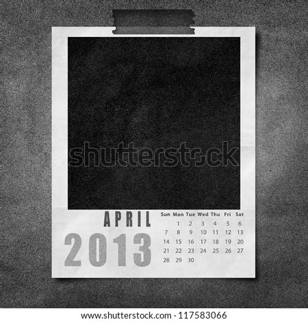 2013 year calendar April on black paper board background