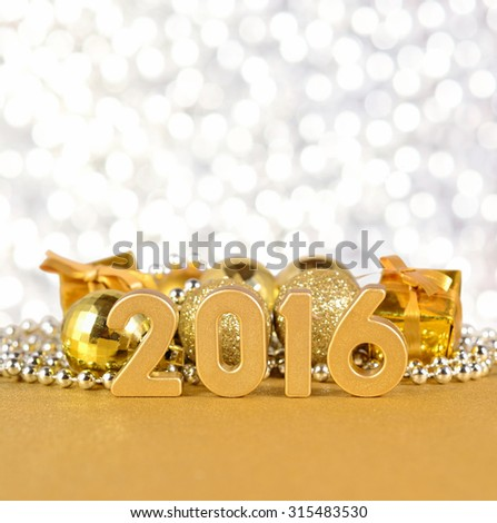 2016 year golden figures on the background of Christmas decorations
