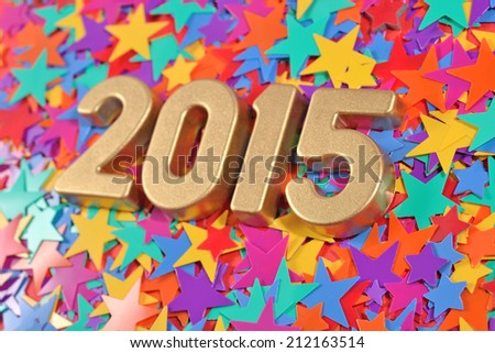 2015 year golden figures on the background of colored stars - stock photo