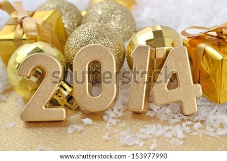 2014 year golden figures on the background of golden Christmas balls - stock photo