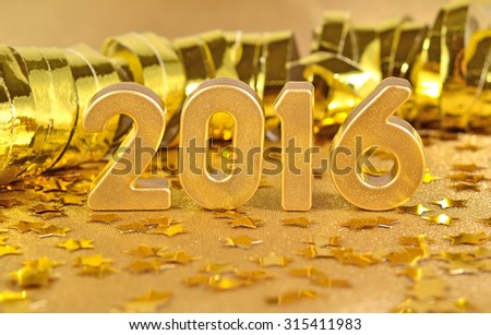 2016 year golden figures on the background of golden stars. Selective focus.