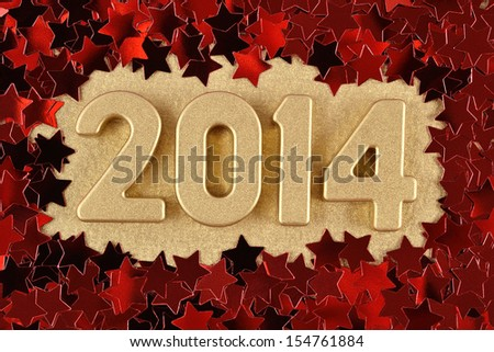 2014 year golden figures on the background of red stars - stock photo