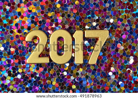 2017 year golden figures on the background of varicolored confetti