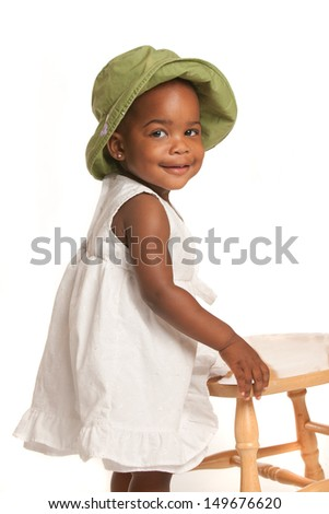 3 year old African American girl in colorful costume with laugh happy expression - stock photo