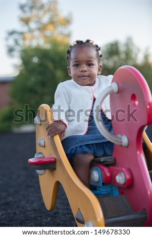 3-year old African American Girl Playing in the Playground - stock photo
