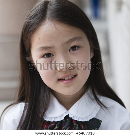 9-year old asian school girl in school uniform