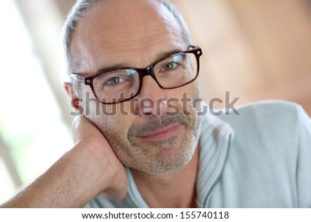 50-year-old attractive man with eyeglasses - stock photo