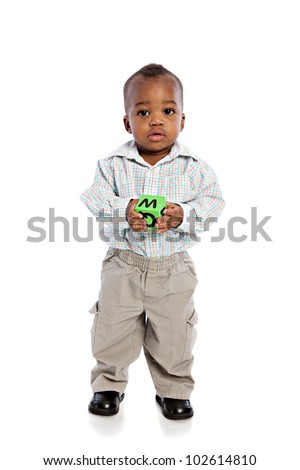 1 year old baby boy standing holding a soft toy ball on isolated background - stock photo
