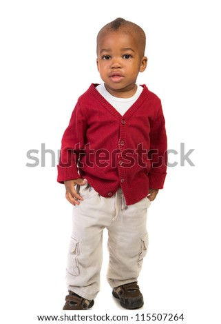 1 year old baby boy standing wearing holiday red sweater on isolated on white background - stock photo